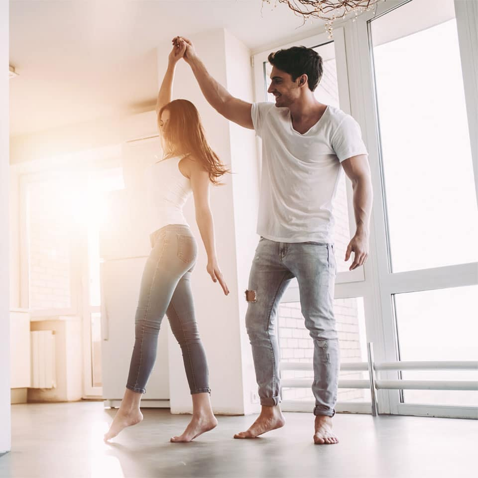Young couple celebrating first mortgage